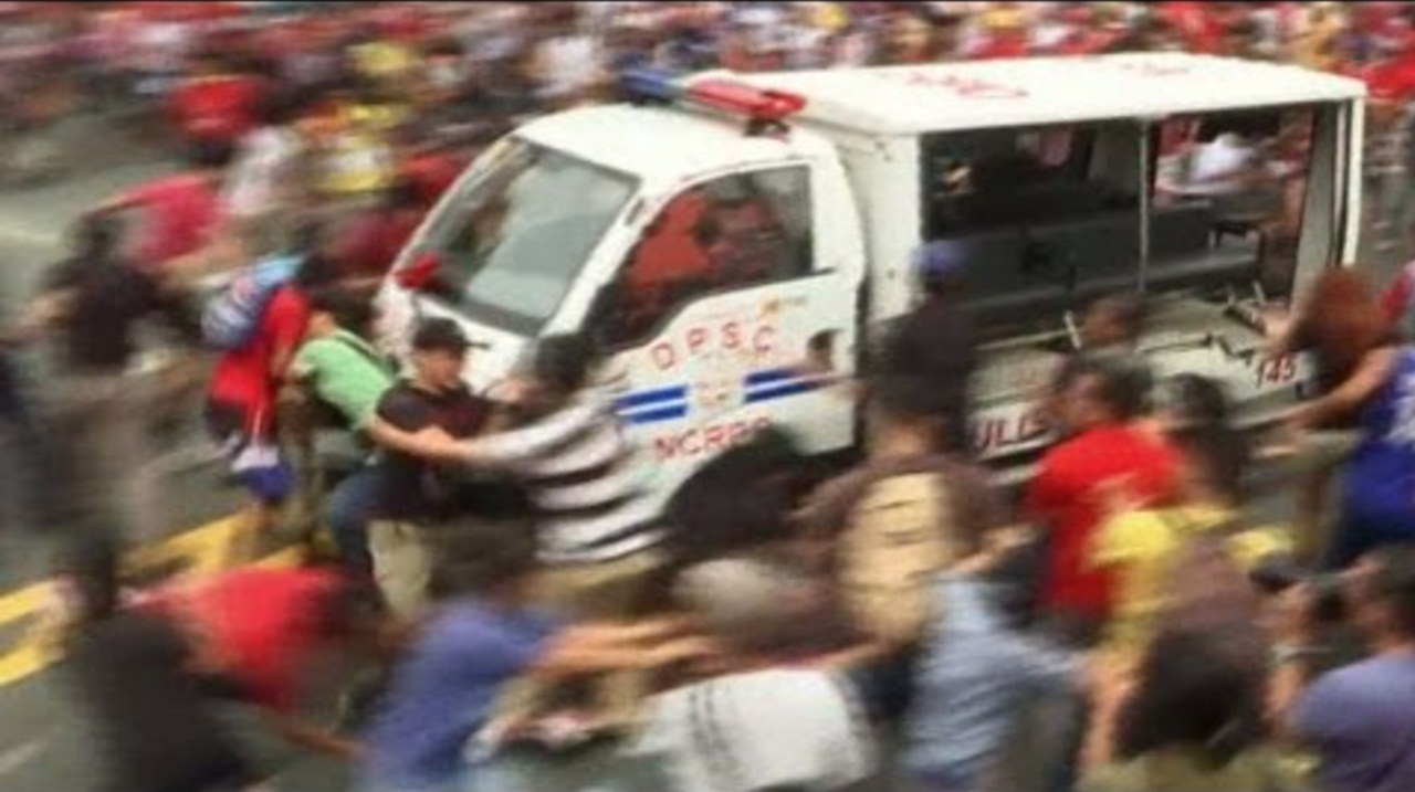 Video: Police vehicle runs over protesters